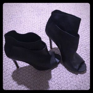 Black leather booties by Chinese Laundry